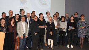 Les 8 lauréats avec Madame la Préfète de l'Aveyron, le Président de la CCI AVEYRON et les partenaires médias